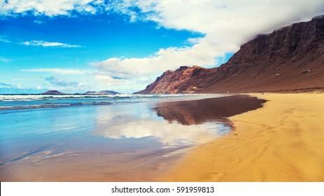 Famara Beach, popular surfing beach in Lanzarote. Canary Islands. Spain.