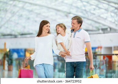 Families with a child in a store