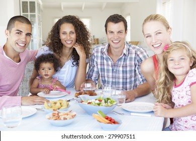 Families Enjoying Meal Together At Home