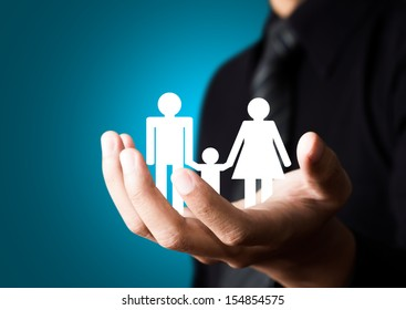 Family abstract in male hand, Insurance concept