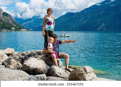 Family admires the view of the mountains in lake garda,Italy