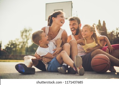 Family after basketball have fun together. Portrait.