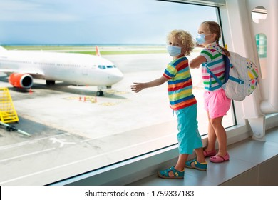 Family in airport in face mask. Virus outbreak. Coronavirus and flu pandemic. Safe travel with young child and baby. Kids boarding airplane in surgical masks.
