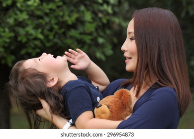 Family Asians. Mother and daughter play. Tenderness baby and mum