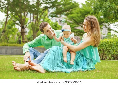 Family with baby in park