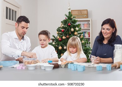 family bakes christmas cookies