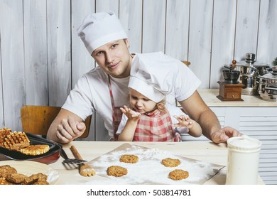 Family, beautiful daughter dad at home the kitchen laughing and preparing food together, with love