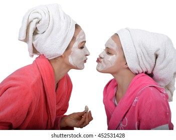 family beauty treatment in the bathroom. mother and daughter make a mask for a face skin. beautician beauty mask. isolated on a white background.