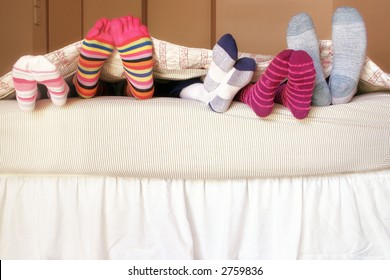 Family Bed:  The kids climb into bed on a weekend morning to snuggle up with mom and dad.