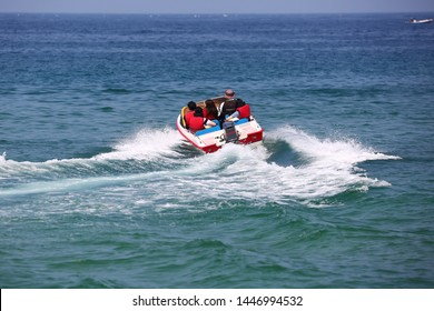 a family with boat on the sea enjoying summer vacation