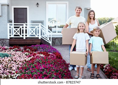 Family with boxes in the house