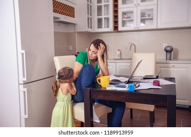 Family budget and finances- young mother with daughter planning home budget