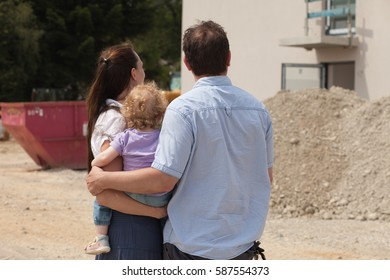 Family building a house - real estate