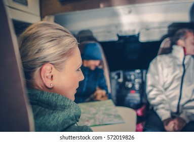 Family in the Camper Van. Family RV Trip. Focus on the Caucasian Woman Seating Inside.Camping and Rving Theme.