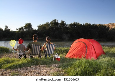Family camping in river