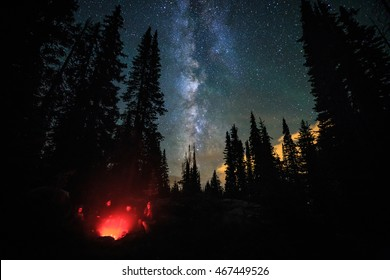 A family camping under the Milky Way in the Rocky Mountains, Colorado, USA.