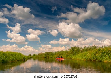 Family in a canoe on the Biebrza river national park, Poland.