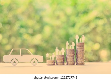 Family car / auto and money loan, financial concept : Sedan car, family members on stacks of coins on a table, depicts borrowing long-term money from lender / creditor or bank to purchase new vehicle