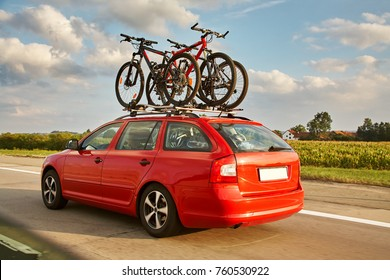family car is transporting bicycles on rack. bikes on the trunk. summer vacation. road travel friends