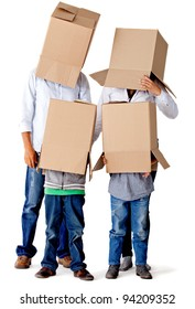 Family with cardboard boxes on their heads in a fun moving day â?? isolated