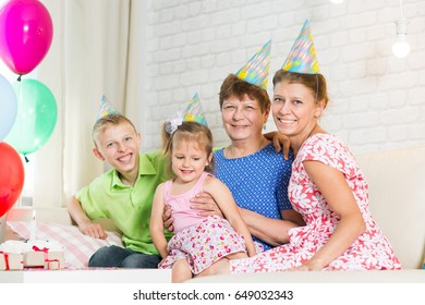 Family celebrating a birthday at the table at home