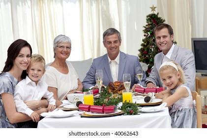 Family celebrating Christmas dinner at home