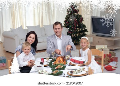 Family celebrating Christmas dinner with turkey against fir tree forest and snowflakes