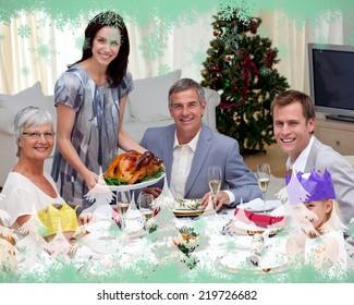 Family celebrating Christmas dinner with turkey against green snowflake design
