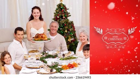 Family celebrating Christmas dinner with turkey against red vignette