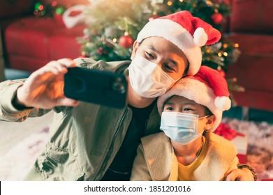 the family celebrating Christmas festival during Coronavirus pandemic. the concept of Christmas, festival, Coronavirus, COVID-19 and health care