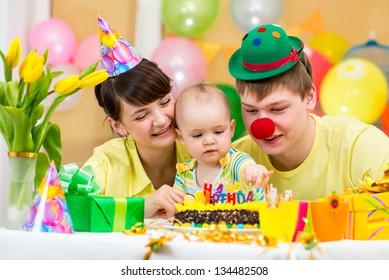 family celebrating first baby's birthday