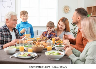 Family celebrating Thanksgiving Day at home
