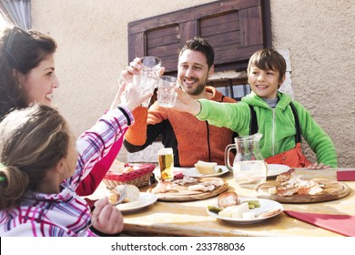 family cheers in a mountain chalet