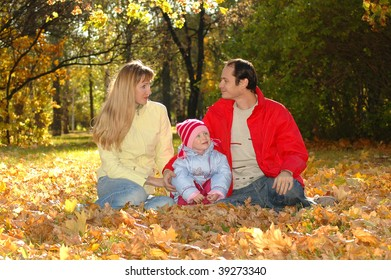 Family with child in autumn park