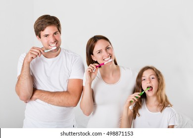 Family And Child Brushing Teeth