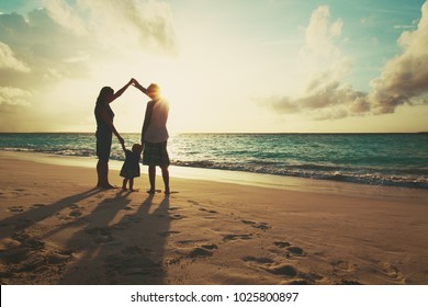 family with child play, have fun on sunset beach, parenting