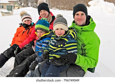 family and child spending time outdoor in winter