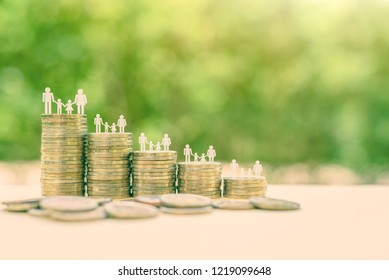 Family or child trust fund / fundraising concept : Family members on stacks of coins on a table, depicts grantor establishes a trust fund to provide financial security to an individual e.g grandchild