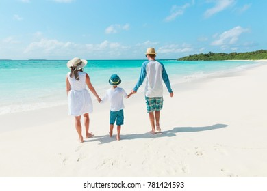 family with child walking on beach