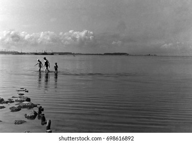 Family with child walking in sea