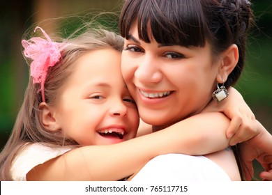 family, childhood, babyhood, parenthood and people concept - close up of happy  baby girl with mother