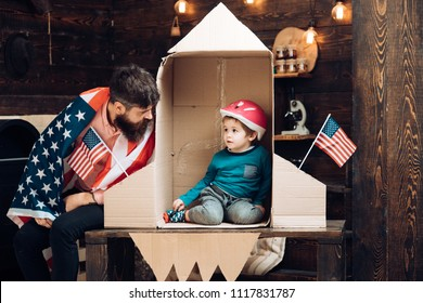 Family and childhood. Happy independence day of the usa. Patriotism and freedom. Travel and adventure. Father and small boy in paper rocket with American flag. Dream about career of cosmonaut.