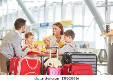 Family with children eating in restaurant before leaving airport or train station