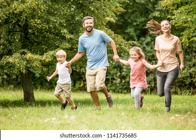 Family with children enjoying summer activities at park