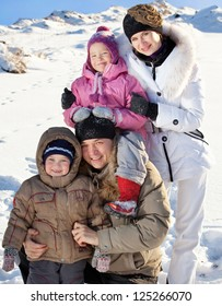 Family with children on snow in winter