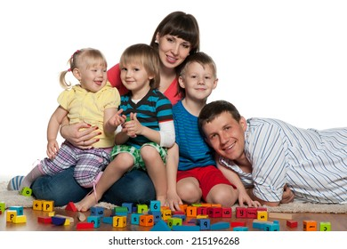 A family with children are playing on the floor