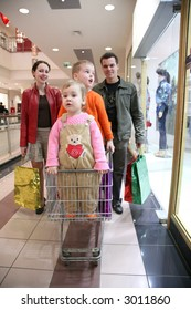 family with children in shop 2
