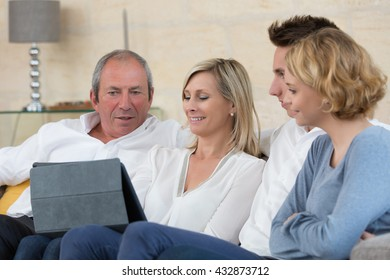 family choosing next vacation on internet