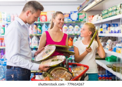 Family is choosing pizza in supermarket.