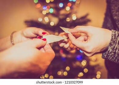 Family christmas tradition. People sharing christmas wafer at eve in Poland.